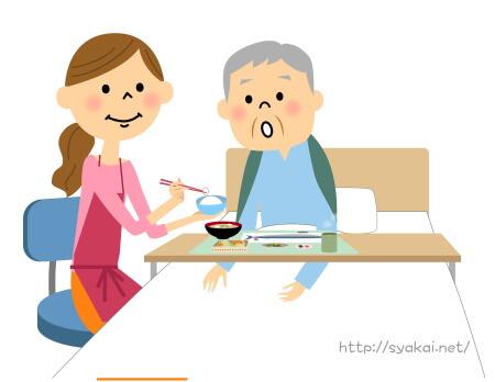 食事の世話をする介護福祉士