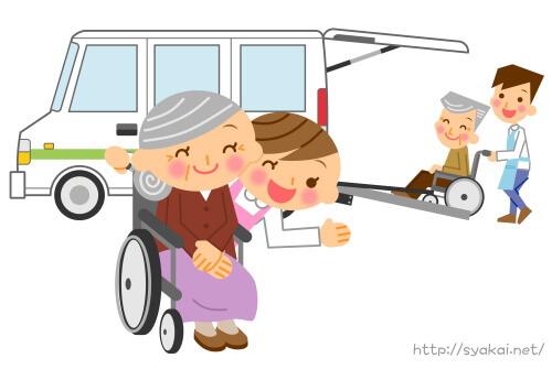 車いすの老人を介護する30代女性