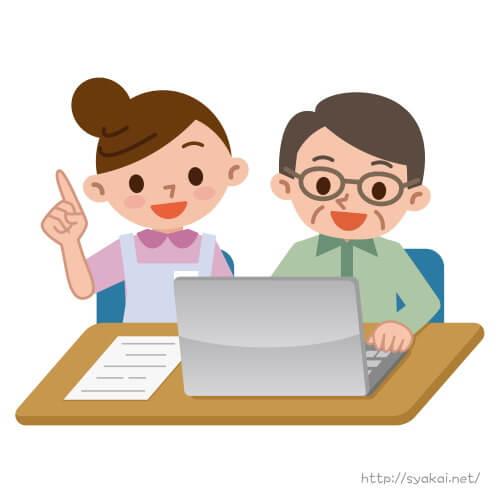 男性にパソコンの使い方を教える介護福祉士の女性